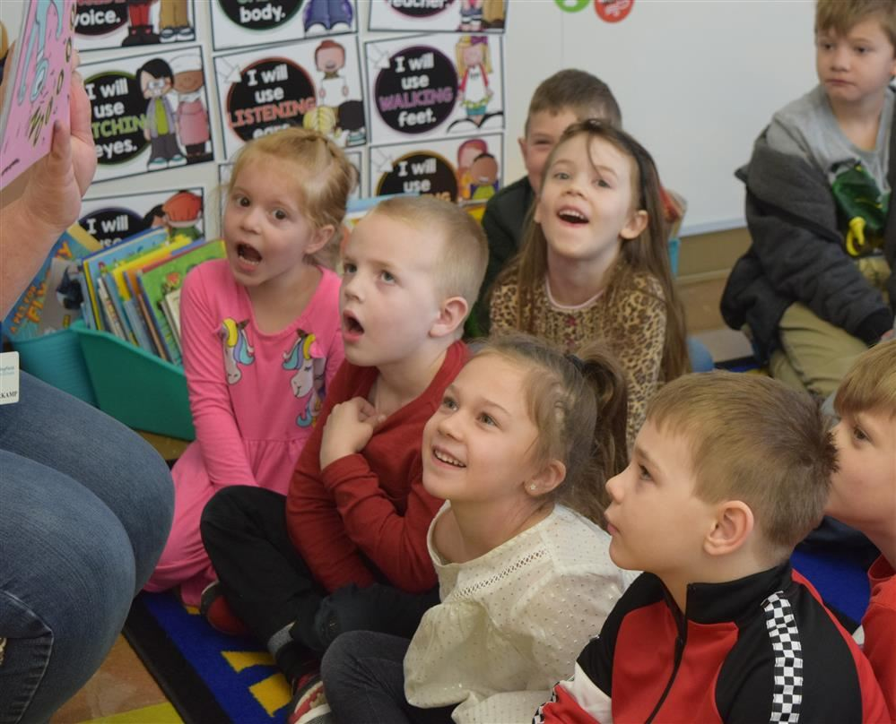 Students listening to teacher read