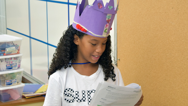 Girl presenting with crown